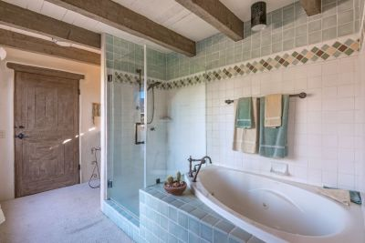 Master bathroom features a glass shower and soaking tub