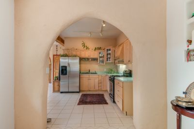 Arched doorway to kitchen from breakfast nook