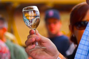 A visitor to the Santa Fe Wine Festival holds a sampling glass. rkimball@abqjournal.com Mon Jun 29 09:43:21 -0600 2015 1435592599 FILENAME: 194647.jpg